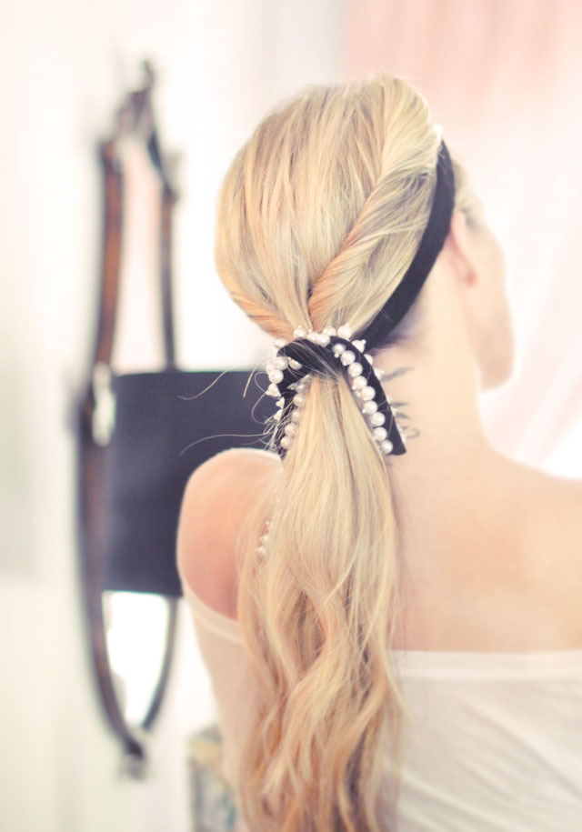 low twisted ponytail with pearl ribbon